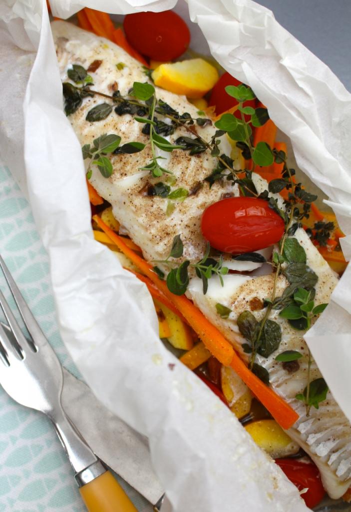 Schelvis in papillotte met courgette, wortel en tomaat